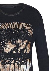 LeComte - MIT GLITZERNDEM FRONT-PRINT UND NIETEN - Long sleeved top - schwarz - 2