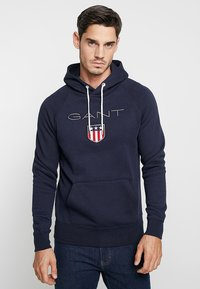 GANT - SHIELD HOODIE - Jersey con capucha - evening blue - 0