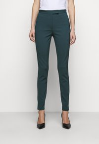Tiger of Sweden - TAIKA - Trousers - scarab green - 0
