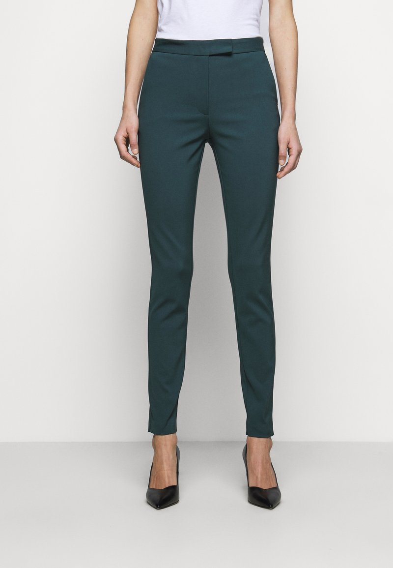 Tiger of Sweden - TAIKA - Trousers - scarab green