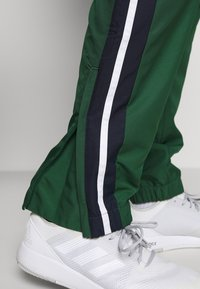 Lacoste Sport - Spodnie treningowe - green - 4