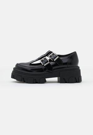CHAUSSURES ET DETAIL DOUBLE BOUCLES - Zapatos de plataforma - black