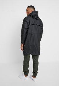 Rains - UNISEX LONG JACKET - Parka - black - 2