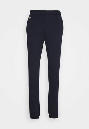 Pantalon de survêtement - marine/blanc
