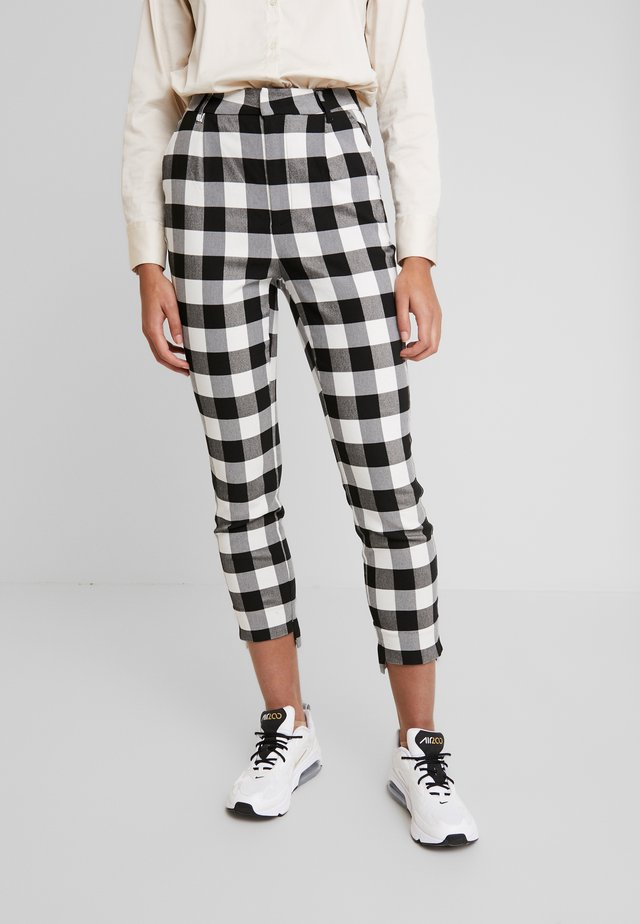 THE CROSS CHECK PANT - Trousers - black/white