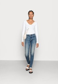 G-Star - MIDGE ZIP MID SKINNY - Jeans Skinny Fit - lt vintage aged destroy - 1