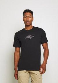 Nike Sportswear - TEE - Print T-shirt - black/white - 0