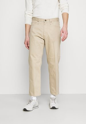EDEN - Trousers - service sand