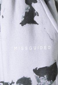 Missguided Plus - TIE DYE JOGGER - Tracksuit bottoms - black - 5