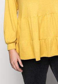 New Look Curves - TIER PEPLUM - Long sleeved top - dark yellow - 4