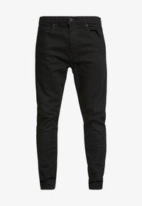 512 SLIM TAPER LO BALL - Slim fit jeans - stylo