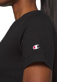 Champion - CREWNECK LEGACY - Print T-shirt - black - 5