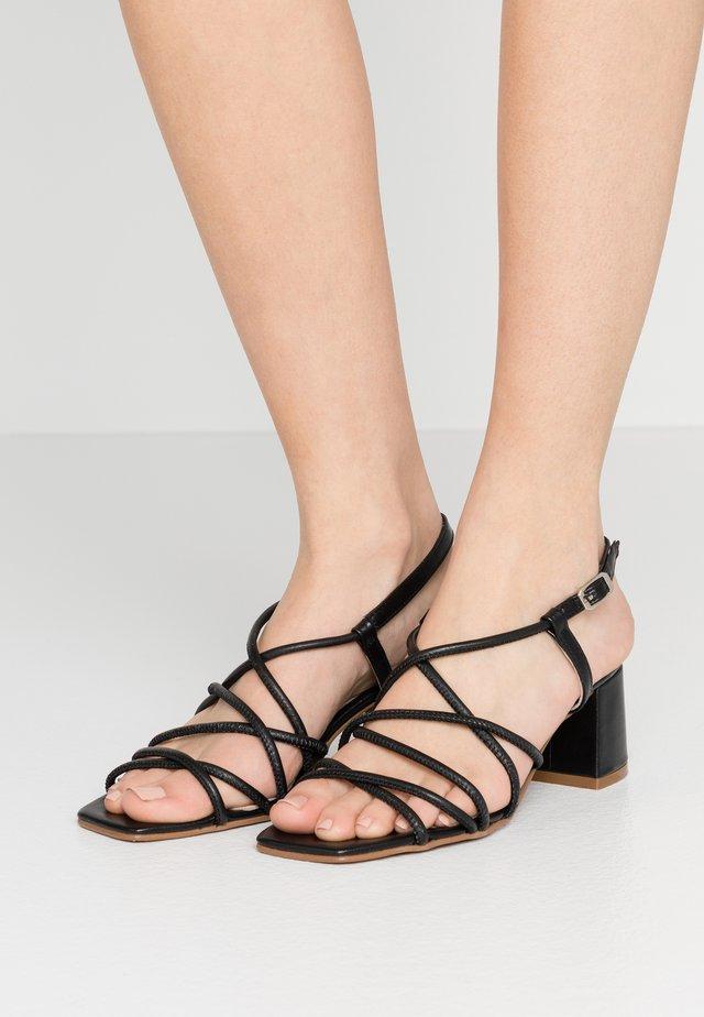 MALAN - Sandaalit nilkkaremmillä - black tibet