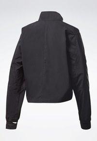 Reebok - RUNNING ESSENTIALS - Training jacket - black - 8