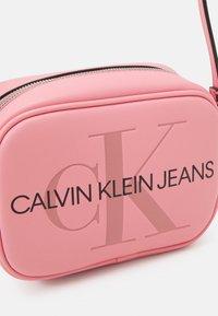 Calvin Klein Jeans - CAMERA BAG - Across body bag - soft berry - 3