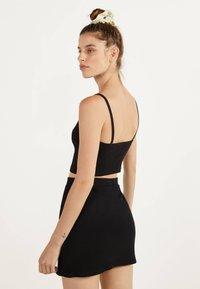 Bershka - KURZER BLEISTIFTROCK 00585019 - Áčková sukně - black - 2