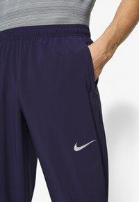 Nike Performance - ESSENTIAL PANT - Verryttelyhousut - imperial purple/reflective silver - 6