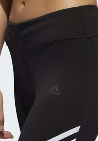 adidas Performance - RUN IT 3-STRIPES 7/8 LEGGINGS - Medias - black