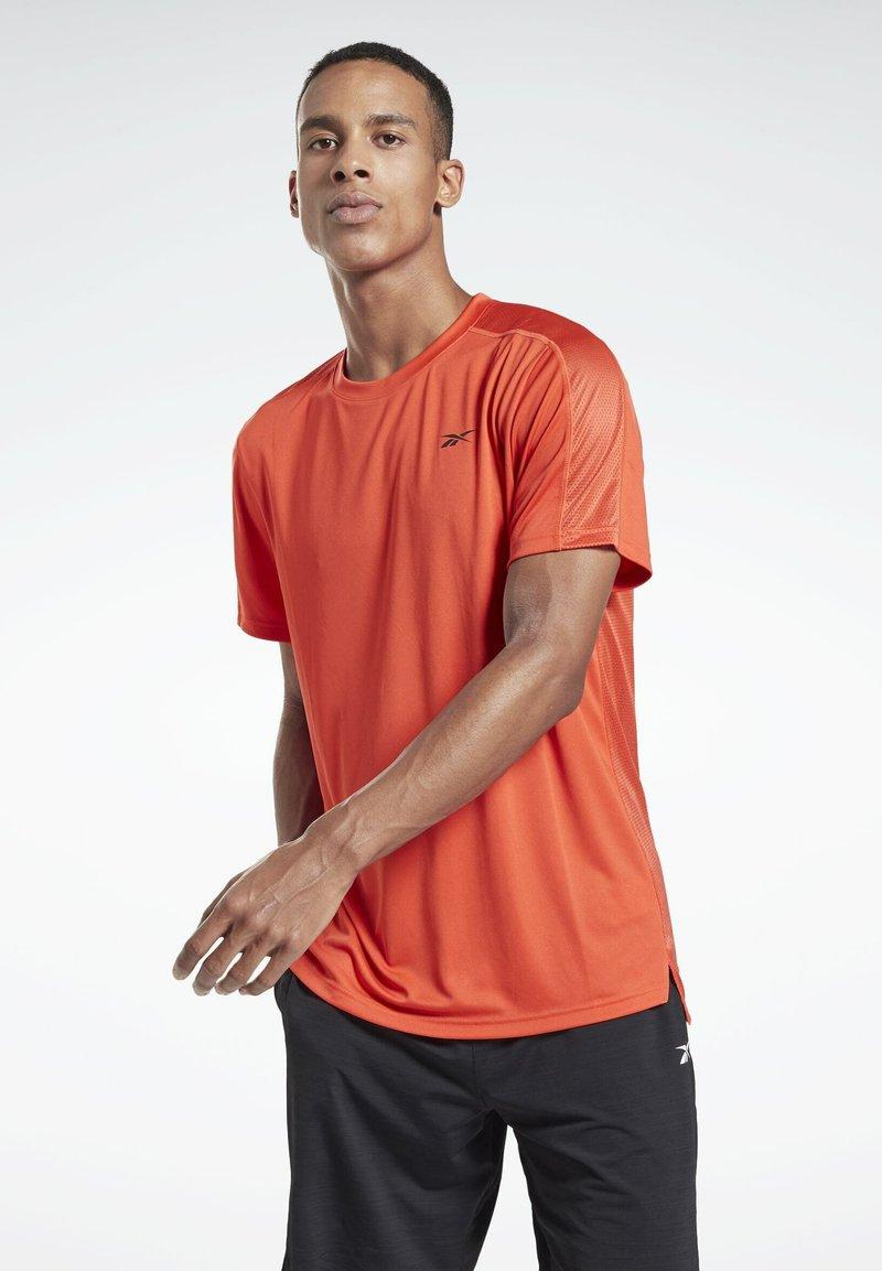 Reebok - WORKOUT READY TECH - Sports shirt - red