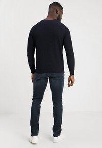 Replay - HYPERFLEX + ANBASS - Slim fit jeans - blue/black denim - 2