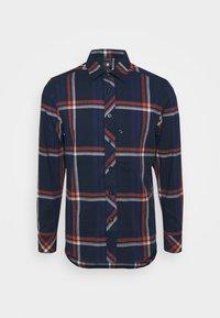 furdan stretch flannel check - cinnamon orange william check