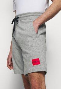 HUGO - Tracksuit bottoms - medium grey - 3