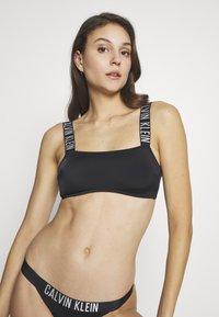 Calvin Klein Swimwear - INTENSE POWER BANDEAU - Bikini top - black - 0