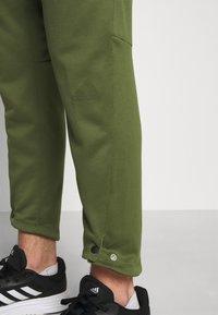adidas Performance - TECH PANT - Tracksuit bottoms - wild pine - 4