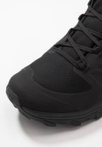 Salomon - OUTBLAST TS CSWP - Winter boots - black - 5