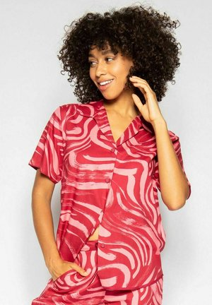 Pyjamashirt - red spiral