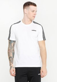 adidas Performance - ESSENTIALS SPORTS SHORT SLEEVE TEE - Camiseta estampada - white/black - 0