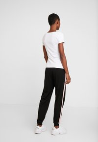 Kaffe - KASIGNE PANTS - Trousers - black deep - 3
