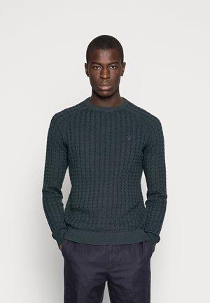 Stickad tröja - mottled dark green