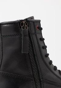 Diesel - D-THROUPER DBB Z - Lace-up ankle boots - black - 5
