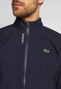 Lacoste Sport - HIGH PERFORMANCE JACKET - Waterproof jacket - navy blue/white - 5