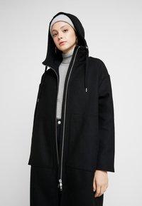 Monki - LEMON HOODED COAT - Kåpe / frakk - black dark - 3
