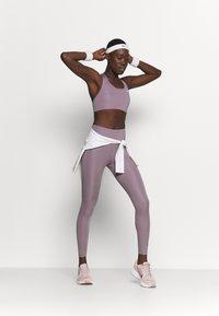 Nike Performance - NON PADDED BRA - Medium support sports bra - purple smoke/white - 1