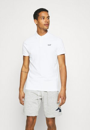 SOLIDS - Polo shirt - white