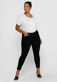 ONLY Carmakoma - SKINNY FIT CURVY CARANTE LIGE REG ANKLE PUS - Jeans Skinny Fit - black - 1