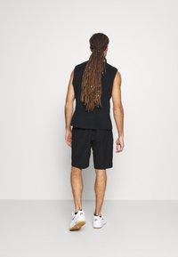 Nike Golf - FLEX HYBRID - Sportovní kraťasy - black - 2