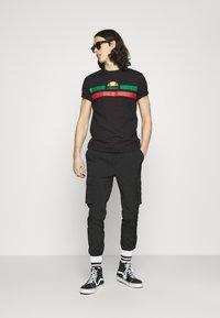 Ellesse - GLISENTA TEE - Print T-shirt - black - 1