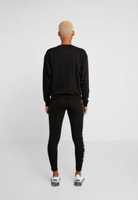 Puma - AMPLIFIED CREW  - Sweatshirt - black - 2