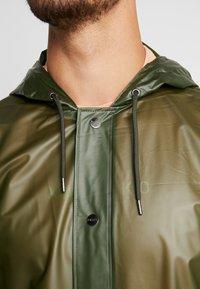 Rains - UNISEX HOODED COAT - Impermeable - foggy green - 6