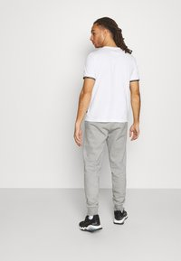 Puma - COLORBLOCK PANTS - Pantalon de survêtement - medium gray heather - 2