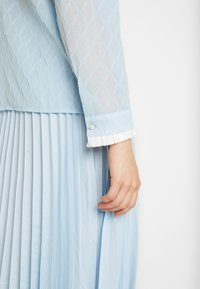 Sister Jane - WANDERING WINGS EMBELLISHED BLOUSE - Button-down blouse - light blue - 5