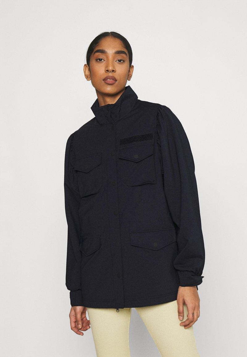 Nike Sportswear - Light jacket - black