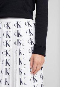 Calvin Klein Jeans - PLEATED SKIRT - A-line skirt - white/black - 4