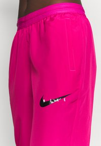 Nike Performance - RUN PANT - Pantalon de survêtement - fireberry/arctic punch/black - 3