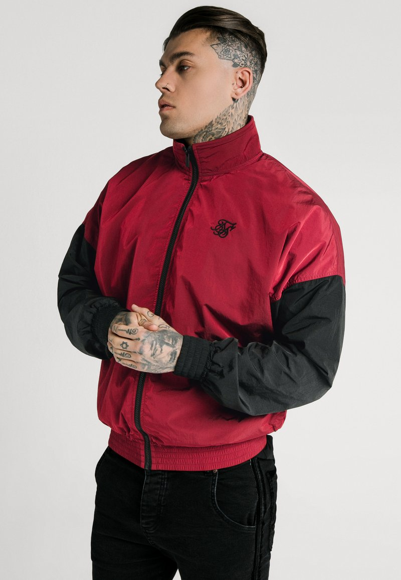 SIKSILK - WINDRUNNER - Giacca leggera - red/black