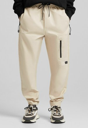 FUNCTIONAL - Cargo trousers - sand